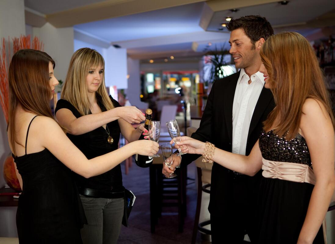 a group of people toasting on a party